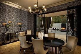 Black Dining Table Beige Chairs And White Patterned Wallpaper Mirrored Cabinet Chandelier Sliding Glass