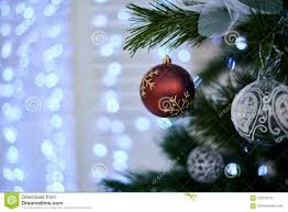 Download Red Christmas Ball On The Artificial Tree Stock Photo
