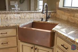 kitchens with corner sinks with copper farm style and cast iron