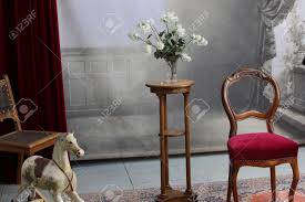 Typical Old Photo Studio With Chair, Table, Flowers, Rocking..