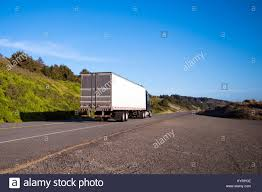 Alone Semi Truck With A Dry Van Trailer Leaves Into The Distance ...