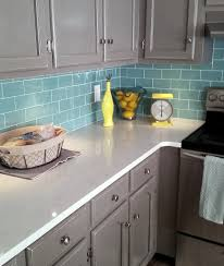 vintage gray wooden kitchen cabinet mixed blue subway tile