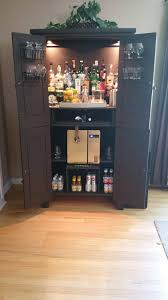 Make Liquor Cabinet Ideas by Upcycled Repurposed Armoire Converted Into A Dry Bar Liquor