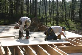 To Accomodate A Thin Slab On The Main Floor Level Which Will Enhance Passive Solar Performance Framing Was Bolstered White Pine Sheathing