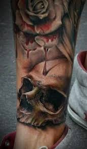 This Is Another Scary Tattoo With Blood Signs And Human Head Skull The Nicely Drawn At Lower Side A Hand Appearing To Press Some Organ