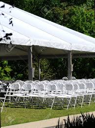 View Of Outdoor Event Seating, Featuring White Folding Chairs..
