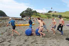 Team Fun And Activities On The Beach At Goat Island