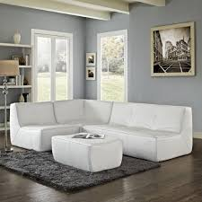 White Sectional Living Room Ideas by Grey Rug And Soft Wall Color For Minimalist Living Room Decorating