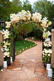 Beautiful Rustic Wedding Arch Flowers Decoration Matched With Some Lovely White Candles And Sparkling Hanging