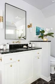 black and white bathroom with pony wall contemporary bathroom
