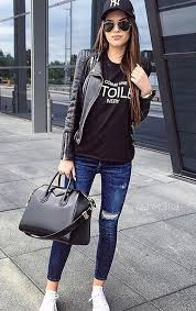 New York Business Lady Wearing Ripped Jeans And Leather Jacket