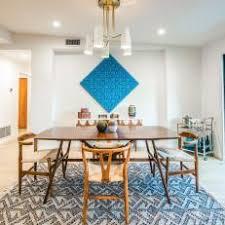 Midcentury Dining Room With Rug