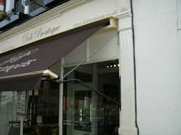 Deli Boutique - Traditional Victorian Awning With Brown Cover And ... Awnings Avolon Blind Systems Retractable Roofs The Victorian Awning Company Huw Otoole Designs Ltd Abbeville Kitchen Original Pergola Design Fabulous Pergolas And Pond Pergola Custom Box A On A Traditional British Fishmonger Or Even Shop Shop Blinds Installed At Betsey Trotwood Deans Handmade Artisan Traditonal Using The Finest Cloth And Delaunay Awnings For Pagnells Of Mount Street Morco Blinds