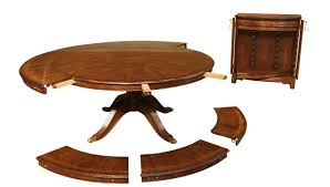 Large Round Traditional Dining Room Table With Leaves And Leaf Storage
