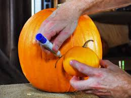 Electric Pumpkin Carving Tools by Halloween Pumpkin Carving A Large Pumpkin Eating A Small Pumpkin