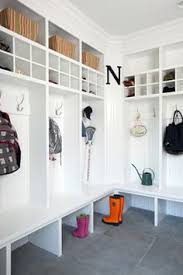 mud room built in storage bench hooks for coats Good use of corner