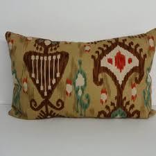 Red Decorative Lumbar Pillows by Shop Ikat Lumbar Pillows On Wanelo