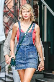 taylor swift wears a denim overalls dress the jeans blog