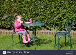 A Toddler Eating Lunch Outside Stock Photo: 79373305 - Alamy Linon Jaydn Pink Kid Table And Two Chairs Childrens Chair Mammut Inoutdoor Pink Child Study Table Set Learning Desk Fniture Tables Horizontal Frame Mockup Of Rose Gold In The Nursery Factory Whosale Wooden Children Dressing Set With Mirror Glass Buy Tablekids Tabledressing Product 7 Styles Kids Play House Toy Wood Kitchen Combination Toys Ding And Chair Room 3d Rendering Stock White 3d Peppa Pig 3 Piece Eat Unfinished Intertional Concepts Hot Item Ecofriendly School Adjustable Blue