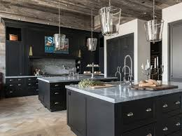Rustic Farmhouse Kitchen With Black Cabinets And Reclaimed Barnwood Shiplap Ceiling