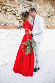 A Red Lace Wedding Dress With Long Sleeves