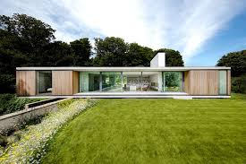 100 Cantilever Homes Modern House Cantilevers Over Stone Wall In England Curbed