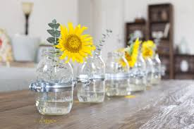Simple And Neat Image Of Dining Room Decoration Ideas Using Yellow Flower Centerpiece Including Unique Clear Glass Bottle Vase Rustic Rectangular