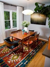 Eclectic Dining Room With Colorful Aztec Rug | HGTV Exciting Eclectic Ding Rooms Boho Style That Can Fit In Top 5 Room Rug Ideas For Your Overstockcom Now You Have The Bohemian Of Dreams Get Look Authentic Midcentury Modern Design By Havenly Amazoncom Yazi Red Mediterrean Tie On 20 Awesome And Decor Photo Bungalow Rose Legends Fniture 6pc Rectangular Faux Cement Set In Chestnut