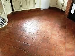 vintage kitchen with terracotta floor tiles