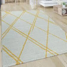 wohnzimmer teppich skandi rauten muster weiß gelb