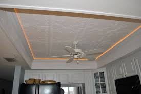 chic flush mounted ceiling fan attached on decorative ceiling tile