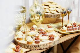 Download Assorted Tasty Finger Food On Wooden Plate At Wedding Reception Stock Photo