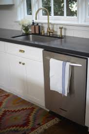 White Kitchen With Brass Sink And Faucet