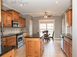 Kitchen W Maple Cabinets With Cherry Stain And Mocha Glaze Uba Tuba Granite Tumbled Marble Backsplash Wall Color