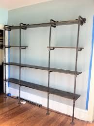 pipe and wood wall shelves