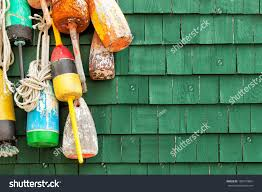 Decorative Lobster Trap Buoys by Lobster Buoys Hanging On Green Wood Stock Photo 180107804