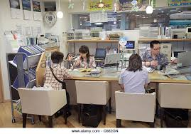 Tokyo Japan Ikebukuro JR Station Travel Agency Clients Employees Agents Asian Man Woman Planning Office