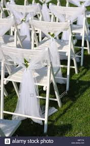 White Decorated Chairs On A Green Lawn. Chairs Set In Rows For The ... 40 Pretty Ways To Decorate Your Wedding Chairs Martha Stewart Weddings San Diego Party Rentals Platinum Event Monogram Decorations Ideas Inside Tables And 1888builders Spandex Folding Chair Cover Lavender Padded Hire For Outdoor Parties In Sydney Can Plastic Look Elegant For My Ctc 23 Decoration White Galleryeptune Aisle Metal Unique Reception Seating