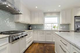 charming beveled glass subway tile with monochrome kitchen