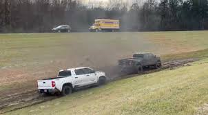100 Truck Dually Ford Throttles Down Makes Huge Muddy Mess Pulling Out Stuck