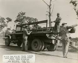 Three Soldiers Working On Modifying A CCKW Truck Into A Boom Truck ...