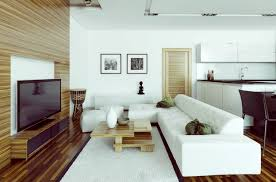 wooden laminate flooring with white sofa and cushions living table