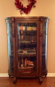 beautiful store quilts in a china cabinet for easy access and