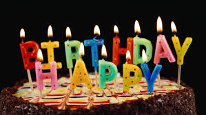 Festive candles HAPPY BIRTHDAY on a cake HD stock footage clip