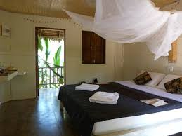 photo d une chambre chambre ร ปถ ายของ ม กล นตา บ ต ค ร สอร ท แอนด สปา เกาะล นตา