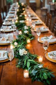 Rustic Garland And Candle Covered Wedding Tables Stylemepretty
