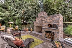 outdoor pizza oven fireplace Spaces Traditional with chaise lounge