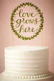 Love Grows Here Cake Topper From BHLDN There Are Some Cute Toppers Like This That Would Match Those Table Numbers And Be Fun If You Could