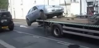 Moron Drives Off Flatbed Tow Truck To Avoid Parking Ticket: Video