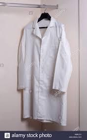 white lab coat hanging on hook stock photo royalty free image